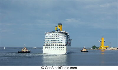 A luxury cruise ship leaving port with two tugs assistance time lapse (Full HD)