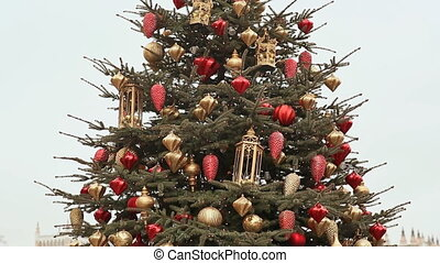 A magnificent Christmas tree, sparkling with lights and beautiful ornaments on the square of Moscow. Close-up. New Year theme.