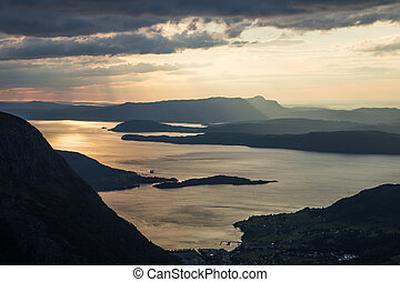 A magnificent sunset scenery over the fjords in Norway. A beautiful autumn landscape in Folgefonna national park.