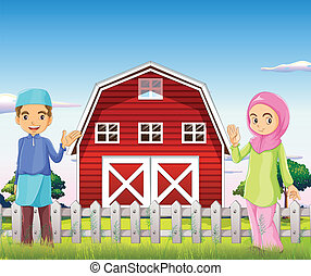 A male and a female muslim in front of a barnhouse -...