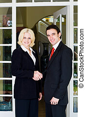 business team - a male and female business team standing at...