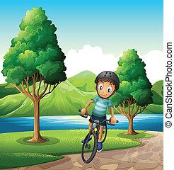 A male biker biking near the river