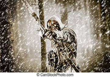A male bow hunter in a forest - A male bow hunter wearing ...
