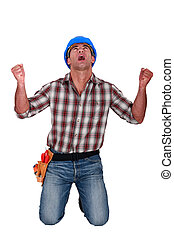 A male construction worker shouting.