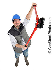 A male construction worker with pliers.
