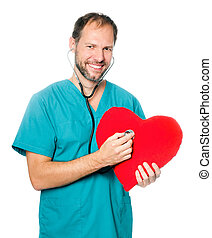 doctor examining a red heart - A male doctor examining a red...