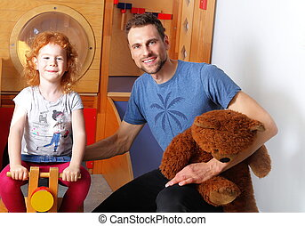 Male educator in Kindergarten with a Child
