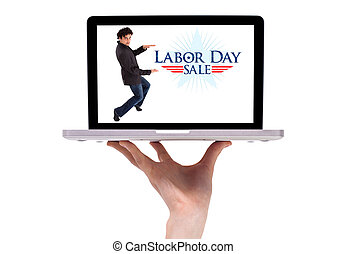 a male hand holding a laptop with a labor day sign