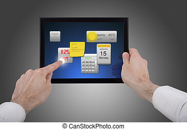 a male hand holding a touchpad pc, one finger touches the...
