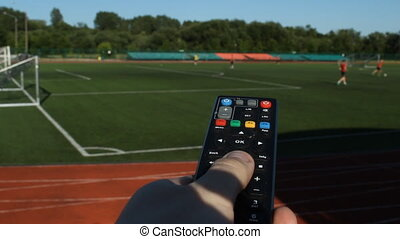 a male hand with a remote control from a TV set against the...