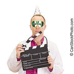 A male medical doctor with a clapperboard