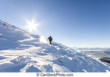 A male mountaineer walking uphill on a glacier. Mountaineer...
