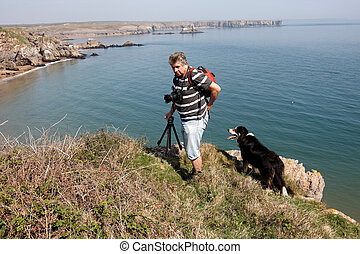A male photographer on the Pembrokeshire coastline
