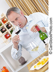 a male sommelier appreciating drink