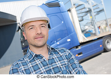 a male worker with truck