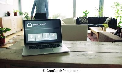 A man and a tablet with smart home screen. - A man and a...