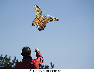 man and kite on sunny day