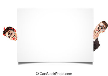 A man and woman looking behind white panel isolated on white