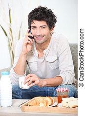 A man at breakfast.