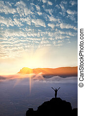 A man at mountain top - A man standing at mountain top with...