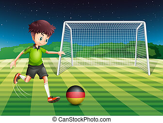 A man at the field using the ball with the flag of Germany