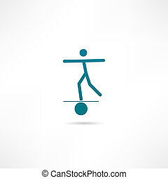 A man balances on a ball