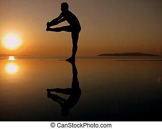 A man balancing.