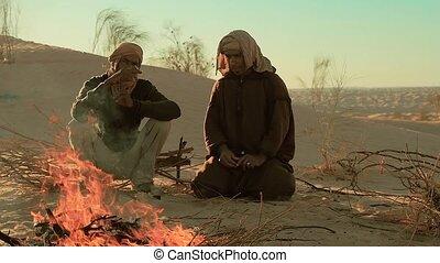 a man camping in the sahara desert