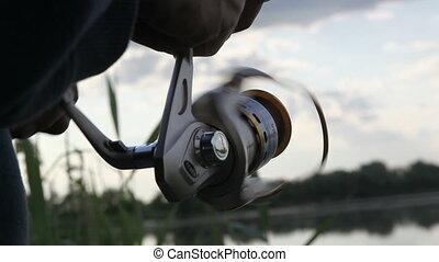 Fishing - A man catches a fish. Fishing