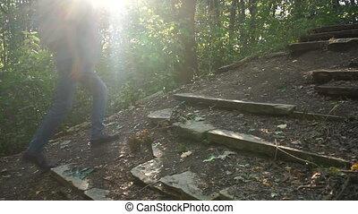 A man climbs up the hill