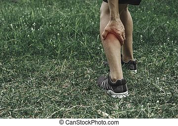 A man clings to a bad leg. The pain in her leg. Health and painful concept.