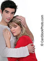 A man comforting his girlfriend.