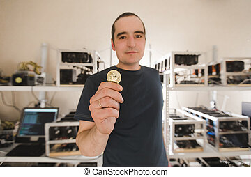A man confidently holds a coin
