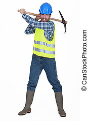 A man construction worker with a pickaxe.