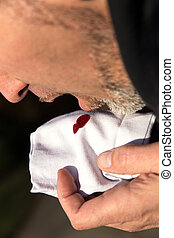a man coughing blood in his tissue
