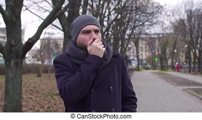A man coughs in the street, slow-motion shooting