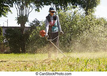 a man cut the grass