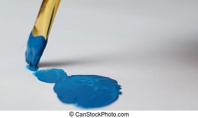 A man draws blue paint on a white sheet of New Year's snowman, close-up, new year 2109, Christmas, New Year's holidays, snowman