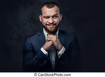 A man dressed in an elegant blue evening suit. - Studio...