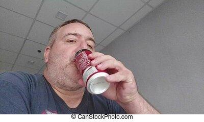 A Man Drinking Soda Slowmo