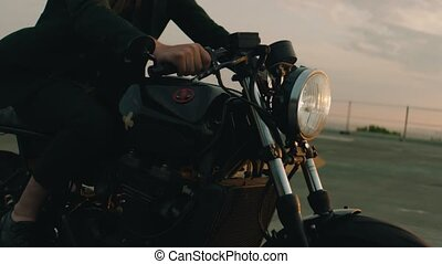 a man driving an old school bike
