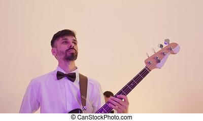 A man drummer and bassist from the musical band playing song...