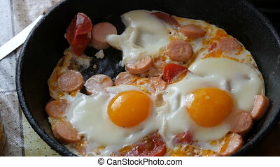 A man eats with a fork a delicious fresh fried egg in a ...