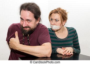 Man enjoying the ban on talking of woman