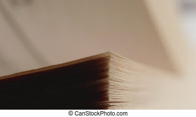 A man flips through pages in a book