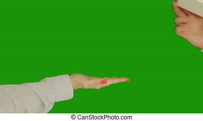 A man gives a woman a gift in a small box with a bow, chromakey