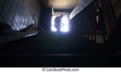 A man goes to the roof - The attic floor, bright light, and...