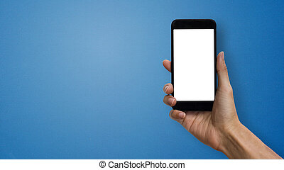 A man hand holding smartphone with white screen and space at left hand on blue background.