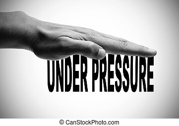 under pressure - a man hand in black and white pressing the...