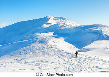 A man hiking in winter mountains